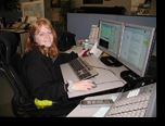 Communications Operator at Her Desk