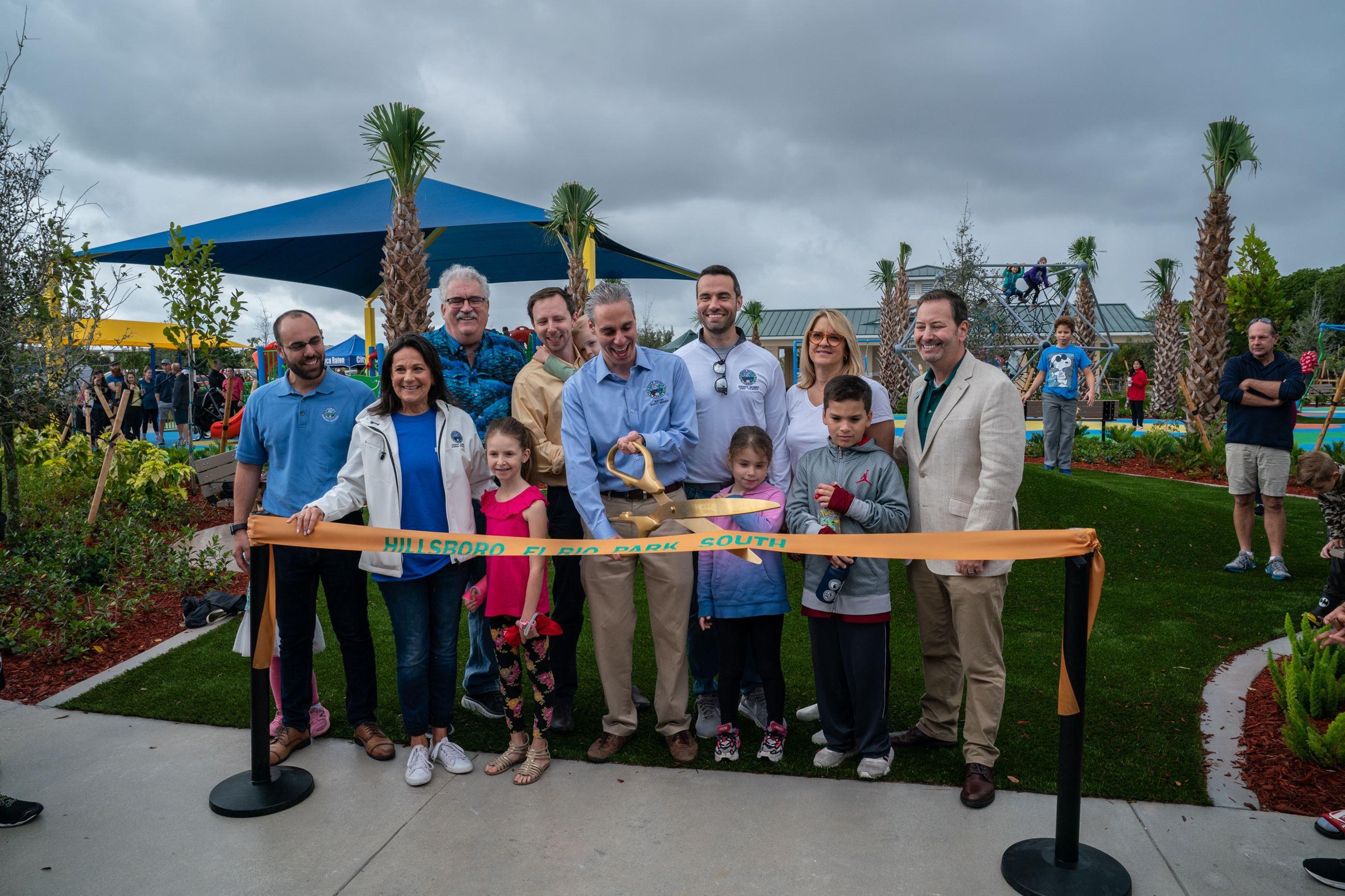city council cutting the ribbon for the park opening